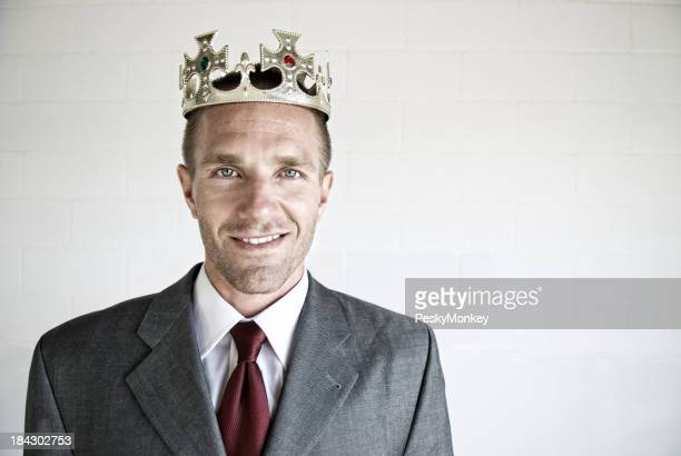 Businessman with Crown Smiles for Portrait