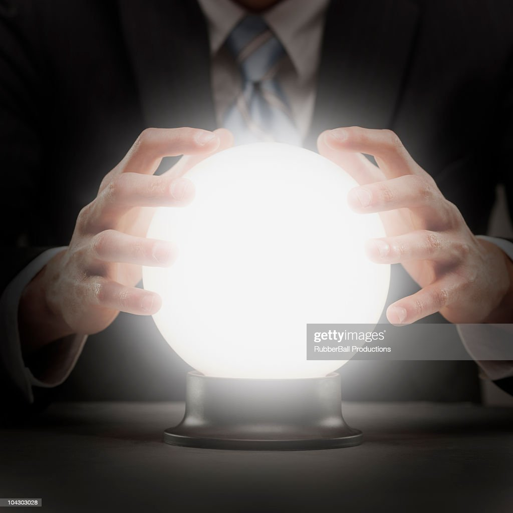 businessman with crystal ball : Stock Photo