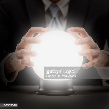 businessman with crystal ball : Bildbanksbilder