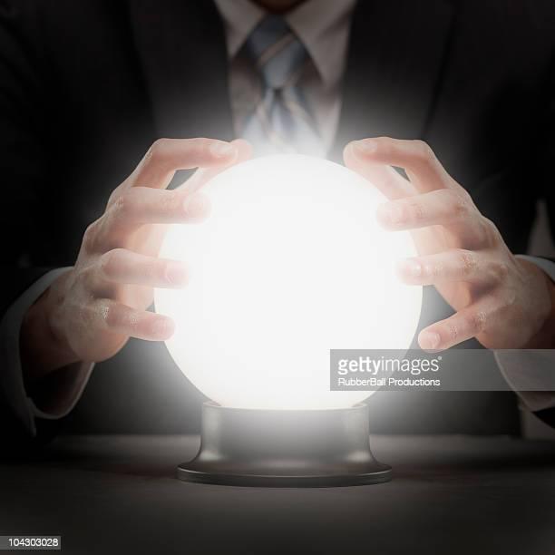 businessman with crystal ball