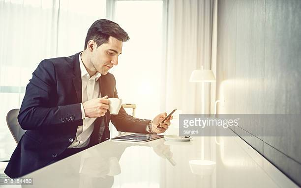 Businessman with digital tablet and phone
