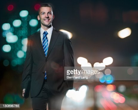 Businessman with digital tablet at night : ストックフォト