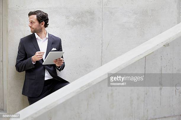 Businessman with digital tablet in a modern building