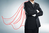 Businessman with drawn red color cape. the concept of success, leadership and victory in business.