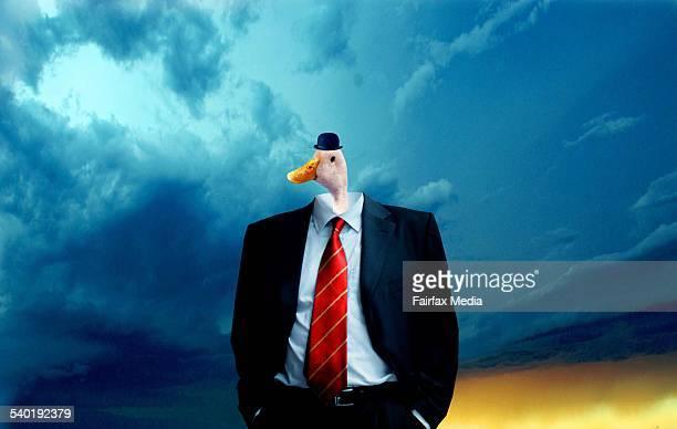 Businessman with duck head against sky