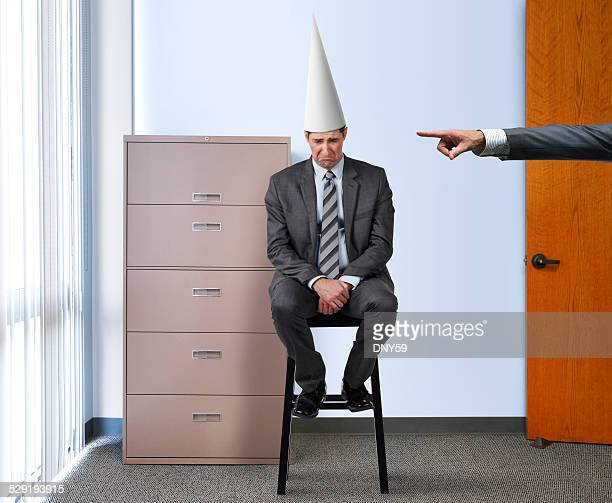 Businessman with Dunce Cap
