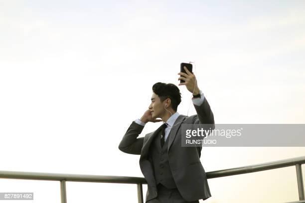 businessman with earphones