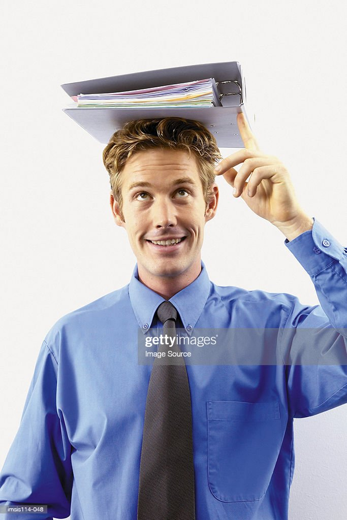 Businessman with file on head