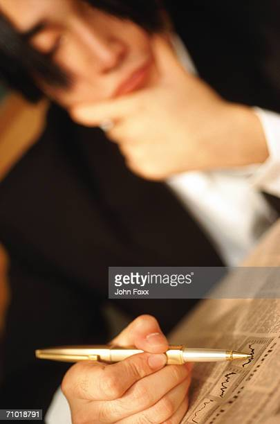 Businessman with financial newspaper