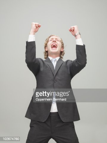 businessman with fists in the air celebrating : Stock Photo