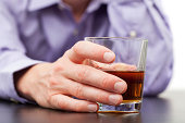 Businessman holding in hand glass of whisky