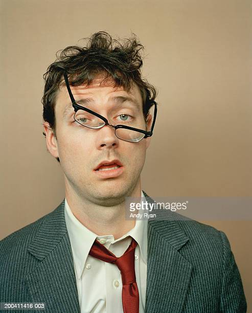 Businessman with glasses crooked on face