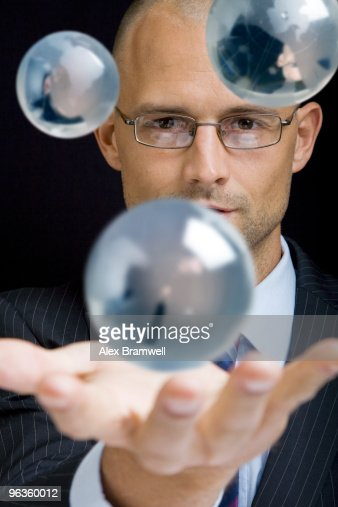 Businessman with Globes : Stock Photo