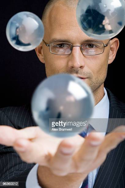 Businessman with Globes