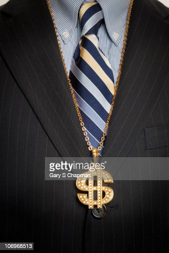 Businessman with gold dollar sign bling necklace : Stock-Foto