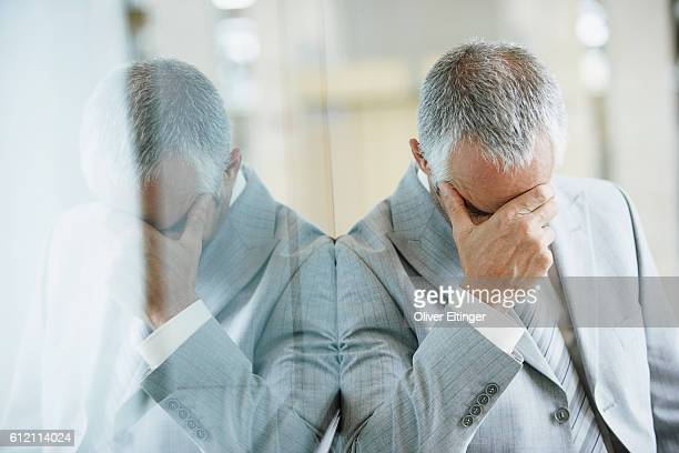 Businessman with hand on his head