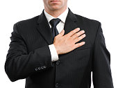 Businessman with Hand Over Heart on White