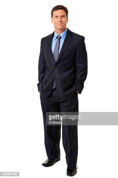 Businessman with Hands in Pockets Isolated on White Background