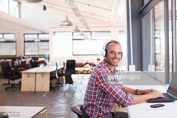 Businessman with headphones working in office