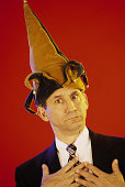 Businessman with jester hat