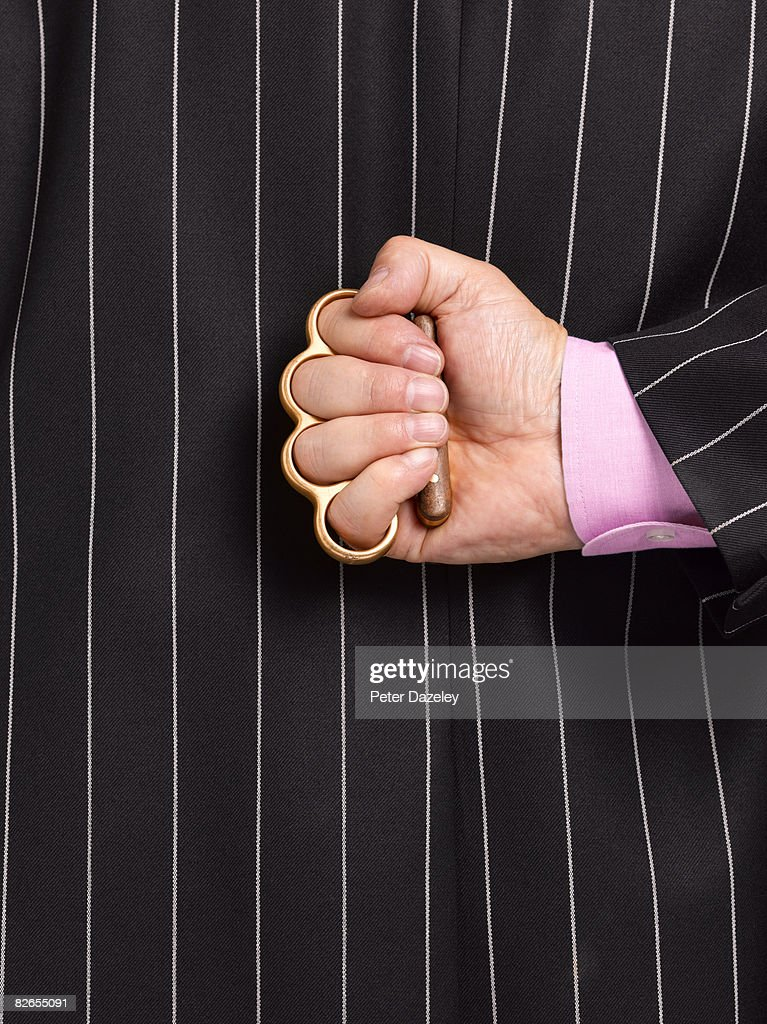 Businessman with knuckle duster : Stock Photo