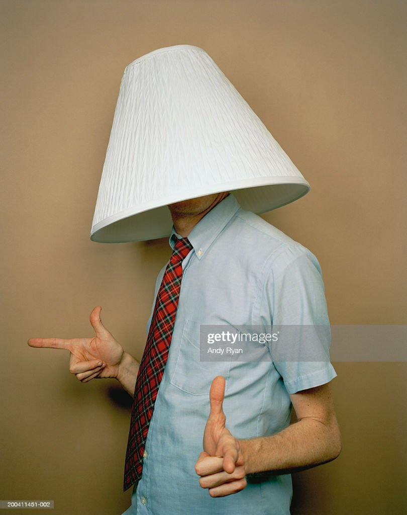 Lamp Shade On Head : Businessman with lamp shade on head stock photo getty images