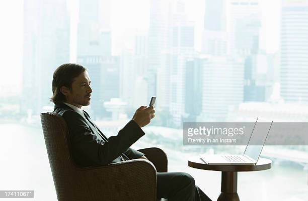 Businessman with laptop and smartphone