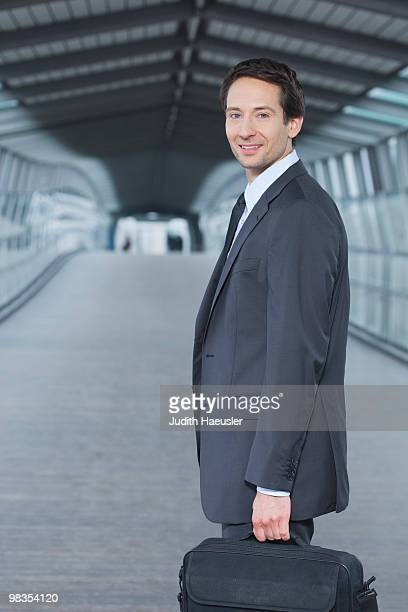 businessman with laptop case, happy