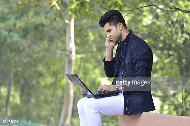 Businessman with laptop in the Park