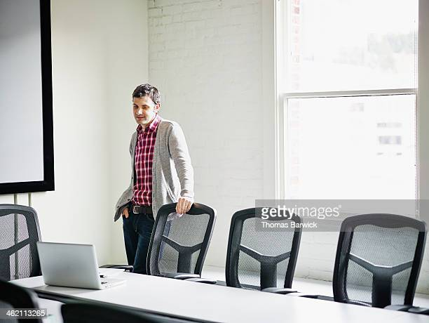 Businessman with laptop preparing for meeting
