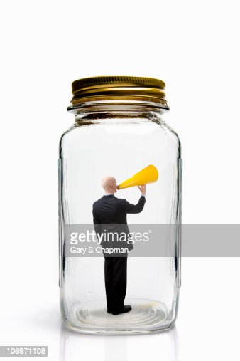 Businessman with megaphone inside mason jar. : Stockfoto