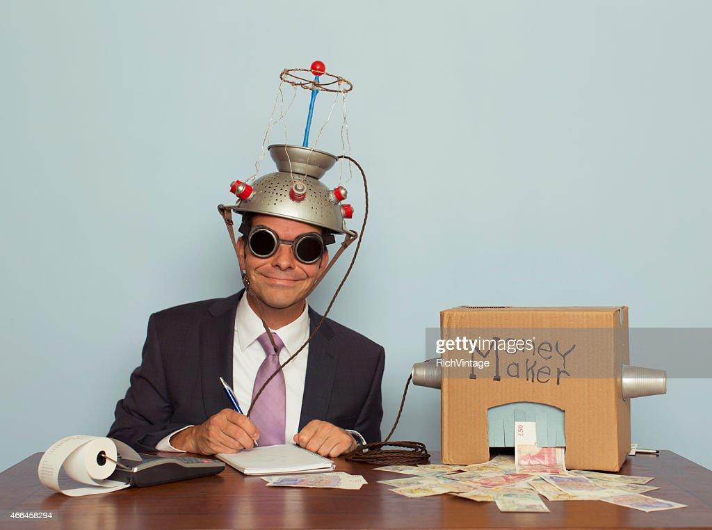 Businessman with Mind Reading Machine Makes Money : Stock Photo