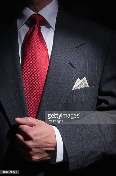 Businessman with money in pocket