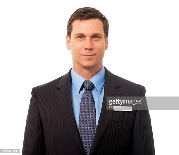 Geschäftsmann mit Etikett isoliert auf weißem Hintergrund