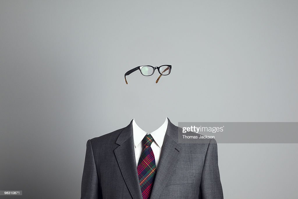 Businessman with no face, looking right : Stock Photo