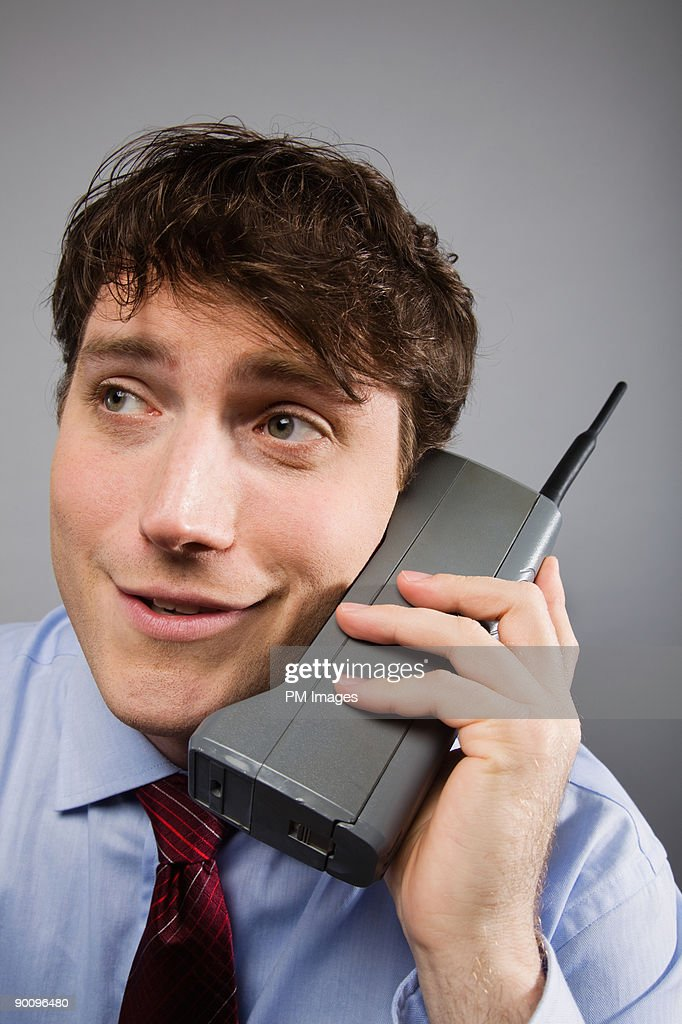 Businessman with obsolete cellphone