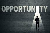 Businessman walks toward an opportunity door