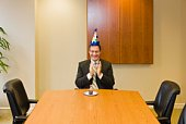 Businessman with party hat and cupcake