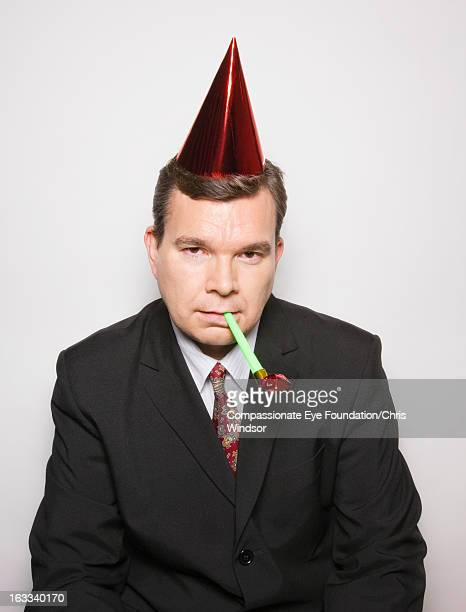 Businessman with party hat and party blower