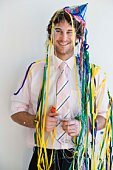 Businessman with party supplies