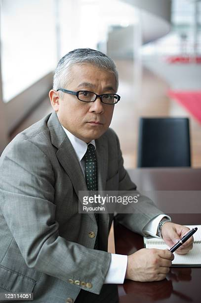 businessman with pen in office