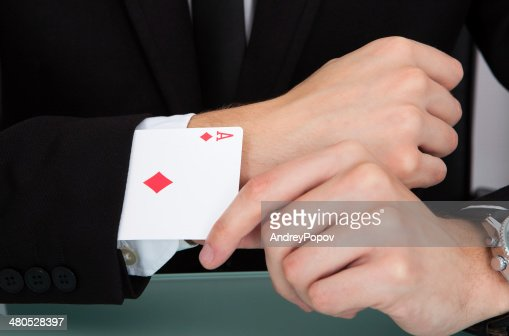 Businessman With Playing Cards In Sleeve : Bildbanksbilder