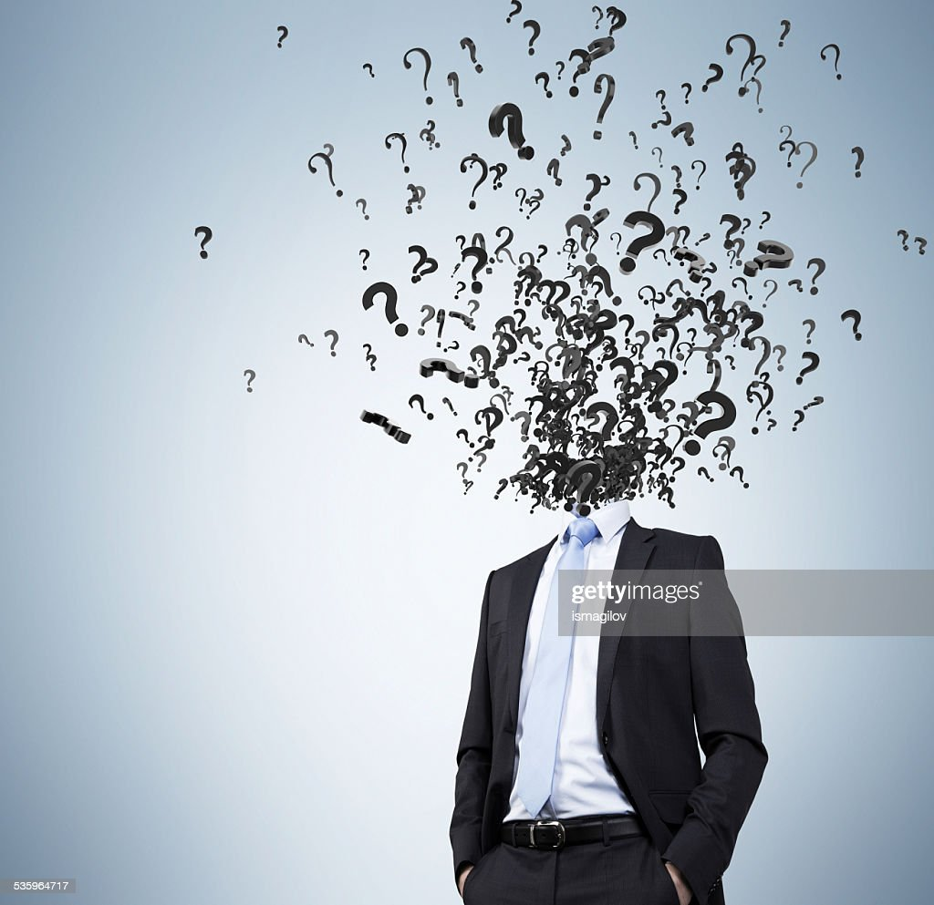 businessman with question marks : Stock Photo