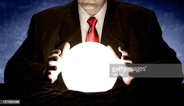 Businessman with red tie consulting crystal ball