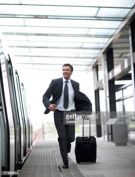 businessman with roller case, on trainstation