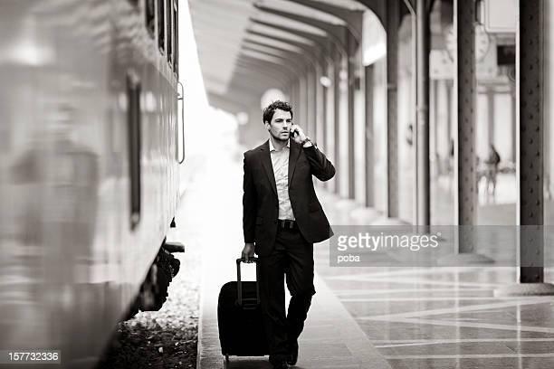 Businessman  with roller case Running For Train on Station Platform