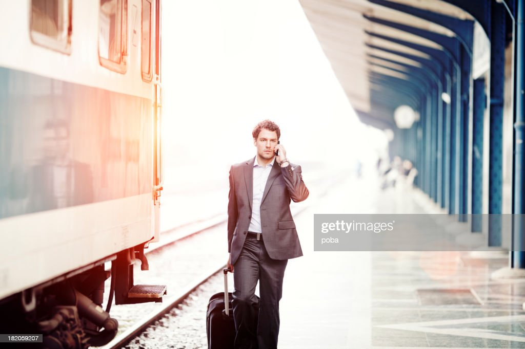 Businessman  with roller case Running For Train on Station Platf