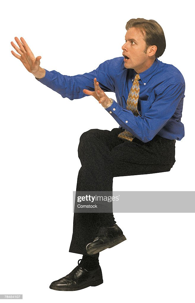 Businessman with scared expression : Stock Photo