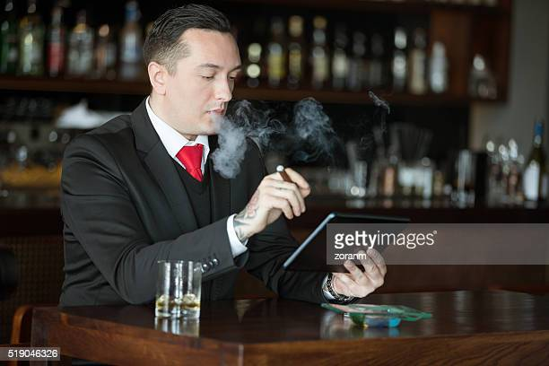 Businessman with scotch and cigar