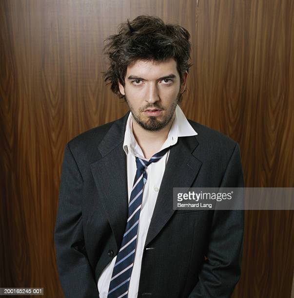 Businessman with scruffy suit and hair, portrait